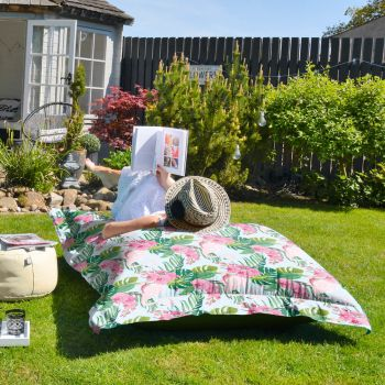 Giant flamingo print Squarbie Beanbag in the garden